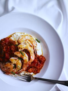 Shrimp 'n Grits -- grilled Gulf shrimp, stone ground grits, Udderly Cool Dairy gouda, tomato-bacon sauce
