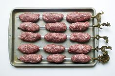The Pylsur, or Icelandic hot dog, is traditionally made of equal parts beef, pork and lamb and seasoned with salt, pepper and fresh thyme. We prepared the pylsur kabob-style, without any casing around the meat. Here we have the meat skewered and ready to grill!