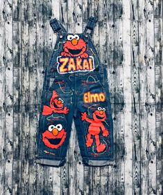 Excited to share this item from my shop: Elmo Sesame Street Cartoon inspired Custom hand painted Birthday overalls skirt, shorts, or pants. Completely open to custom orders! 1st Birthday Outfit Boy, Boys First Birthday Party Ideas, Elmo Birthday, Boy Birthday Parties, Dinosaur Birthday, Elmo Party, Mickey Party, Dinosaur Party, Baby Moana Costume