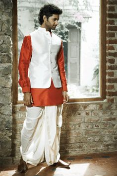 Classic bundi, silk dhoti and kurta by Anita Dongre