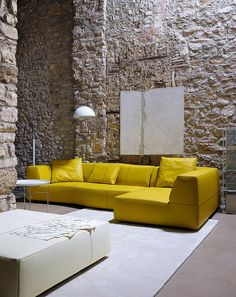 Stone walls and bright sofa