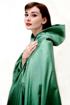 Audrey Hepburn wearing a Givenchy cape in a promotional photo for Funny Face (1957)
