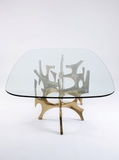 Fred Brouard; Glass and Polished Bronze Dining Table, c1975.  Would like it better as a coffee table with rounded corners but without things to jab you under the table!