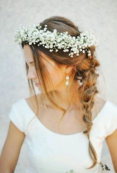 Beautiful boho inspired bridal hair with a babies breath crown.