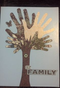 traced family members' hands onto scrapbook paper and mod podged onto a painted canvas