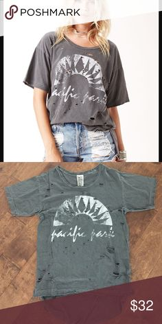 Free People We The Free Pacific Park Destroyed Top Free People We The Free Pacific Park Destroyed Top new never worn. Tag is cut to prevent store return. Size xs but will fit a size small or medium as well Free People Tops Tees - Short Sleeve