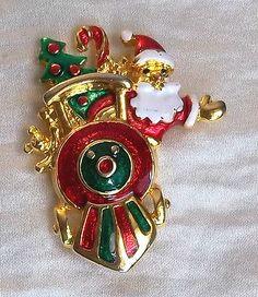 Vintage Christmas Pin Gold Tone Red Green Enamel Train Santa.