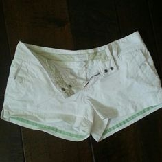 American Eagle White Shorts Double snap enclosure with zipper.   Two front slash pockets with snaps, and two back pockets with snap closures. American Eagle Outfitters Shorts