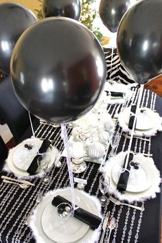 Black & White & Silver & Shimmer party theme: Each napkin is tied with ribbon & attached to a black balloon.