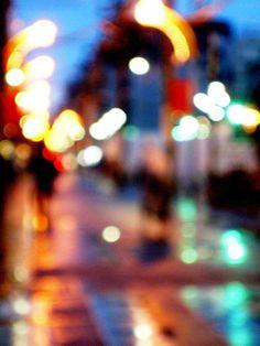 Shopping street in the night rain by tanakawho, via Flickr