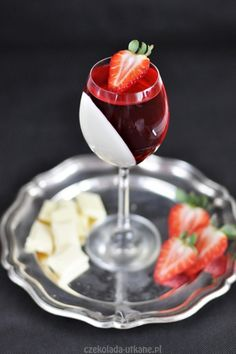 Panna cotta with white chocolate, jelly and strawberries.