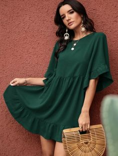 Babydoll dress in dark green. Very short, but cute with nude sandals or wedges! Flounce hem and sleeves.