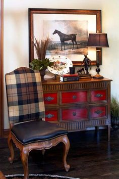 Dresser with Red Accents and Plaid Chair
