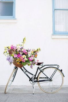 Spring Flower Arrangements flowers in a bike basket: