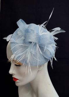 A pale powder blue sinamay has been used to make this fascinator, a circular saucer style approx 8 inches across, topped with sinamay loops and a