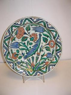 An Iznik pottery Dish with a Saz leaf and roses Turkey 17th Century