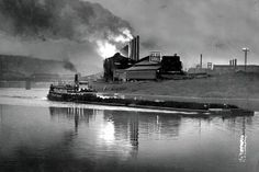 J&L Steel on the South Side is silhouetted against the Pittsburgh skyline May The mill has since been torn down, replaced with the thriving SouthSide Works complex. Pittsburgh Skyline, Pittsburgh Sports, Pittsburgh Neighborhoods, Iron Furnace, Pennsylvania History, Steel Mill, Train Art, Industrial Photography, Historical Photos