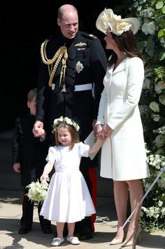 Kate gazed lovingly into William's eyes while a shy Prince George hid from the cameras fol...