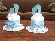 These Diaper Cakes will be the hit of your Baby Shower! Mini cakes come with 7 size one diapers and start at $9.50 each! Add a dollar if you want them double sided. Those with Baby Pins are $10.00 I can do any ribbon designs a to match your invite. I can stick them on the base and have different