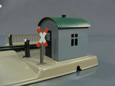 OLD GERMAN MARKLIN TRAIN TOY RAILROAD LEVEL CROSSING HO,worked by pressure of the train