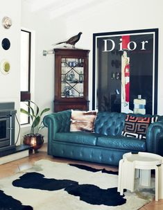 The Brisbane home of Michael Zavros, Alison Kubler and family. Artwork above fireplace -Donna Marcus, Southport (detail). Vintage Rene Grau Dior poster behind couch. Photo – Jared Fowler, production – Lucy Feagins / The Design Files. #chesterfield