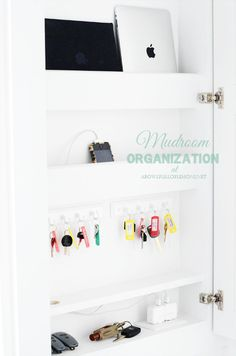 A Bowl Full of Lemons Mudroom - create a cabinet to hold all your electronics, keys and other grab and go must-haves