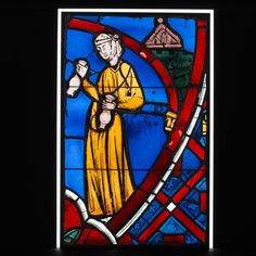 Woman Dispensing Poison from the Legend of Saint Germain of Paris Date: 1245–47 Geography: Made in Paris, France Culture: French Medium: Pot-metal glass, vitreous paint Dimensions: Overall: 25 1/8 x 15 3/4 in. (63.8 x 40 cm)
