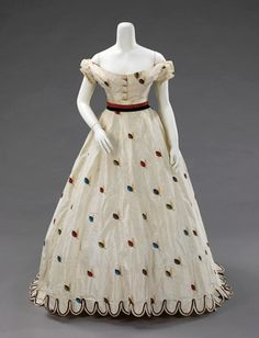 """Evening/Afternoon Ensemble, With Evening Bodice, Texier St. Engley: ca. 1875, French, silk. """"An air of coquettishness and youthful presence inform this set of French dress coordinates. The colorful and spritely decorative details lend a sense of whimsy. The choice of fabric and the inclusion of alternate bodices made this ensemble appropriate for both late day and evening wear."""""""