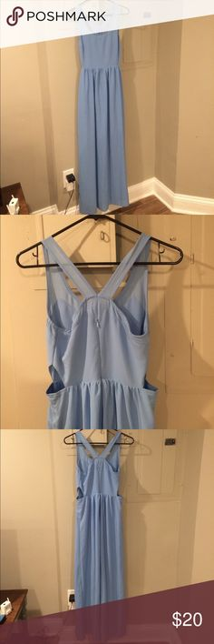 Baby blue maxi dress Barely worn soft baby blue maxi dress. Zips in back with v style straps. Subtle cutouts triangle cut outs on sides above waist. Dress has nice skirt lining so no worries about see-through mishaps! Alya Dresses Maxi