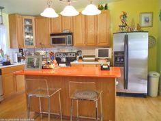 I love this Orrington kitchen! The orange island counter and the white subway tile...lovely!