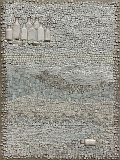 Heaven Revisited by Jo Braun    Twenty-one shades of white glass, antique bottles, and cement mortar on hand formed cement panel.  40 inches h x 28 inches w x 3 inches d