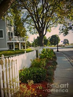 Sidewalk Stroll I by Desiree Paquette. Available online at Fine Art America. keywords: nostalgia, nostalgic, small town America, americana, neighborhood, picket
