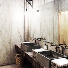 Concrete sinks, exposed plumbing