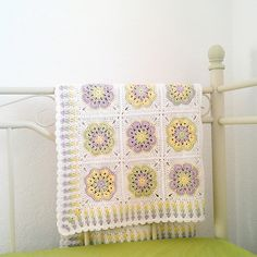 The stitch used for the border is called Granny Spike Stitch. Here's a tutorial http://bunnymummy-jacquie.blogspot.com.by/2011/01/granny-...