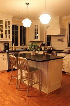 Love this kitchen: white inset cabinets, subway tile backsplash, pot filler over the stove, honed black granite countertops.
