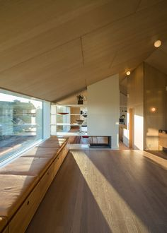 Interior shot of a timber-clad home that sits on a hill overlooking Oslo.