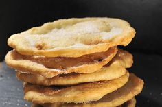 BUÑUELOS are a typical snack in most latin american countries. they consist of a simple, wheat- based yeast dough and are considered an 'essential dish' in Mexican cuisine.  For easy and quick preparing: deep fry a wheat flour tortilla (from AztecA, of course) until crisp and golden brown. Before it cools down, sprinkle with sugar and cinnamon. Enjoy together with a cup of hot chocolate. (Calories? Don't even mention them!!!)  Enjoy!