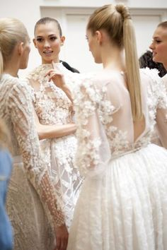 The sleek ponytails, the stunning hand-crafted Elie Saab dresses, all of the sleeves (oh yes, I love a wedding dress with sleeves.) Call me old fashioned. Found via The Cinderella Project // Image via Elie Saab Elie Saab, Glamour, Looks Vintage, Anja Rubik, Mode Inspiration, Wedding Inspiration, Wedding Ideas, Emilio Pucci, Beautiful Dresses
