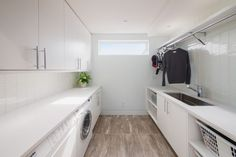 Sleek and stylish all-white contemporary laundry room! - Decoist