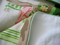 side zipper, piping and a lining. how to do all three in one pillow tutorial. from needle book.