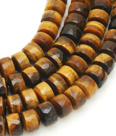 Tiger Eye Faceted Barrels 7x10mm.  Use tiger's eye to help with issues of self-worth, self-criticism and blocked creativity.