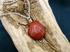 Camino journey necklace ~ Red Jasper scallop shell. A traveller's companion for protection and strength. This Red Jasper scallop shell necklace is THE ideal present to give someone about to embark on a journey or undertake a new venture. Red Jasper is a protective gemstone and believed to promote courage and physical stamina. The scallop shell is the symbol of the Camino de Santiago.