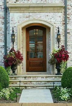 I love this look...French country...old stone, brick trim above ...