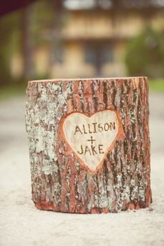 Tree stump with carved names. Cute idea for thing for the wedding!!!! :) Pretty much in love, need to make this happen!