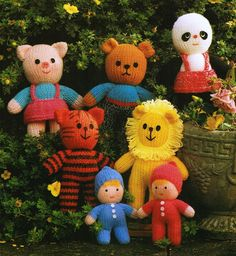 """Meet 'The Super Seven' probably some of Jean Greenhowe's earlier designs. The patterns are easy to follow and to do. They are made using DK wool and a few other bits and pieces. Each animal (Lion, Tiger,Panda, Bear and Pig) is about 25cm/10"""" tall. The dolls are about 18cm/7"""" tall. These versions of the patterns were featured in Jean Greenhowe's """"Knitted Toys"""" book published by Book Club Associates in 1986."""