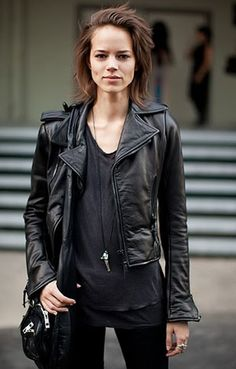 It's hard to beat the classics: biker jacket + v-neck t-shirt + skinny jeans + long silver pendant. I imagine that combat boots appear somewhere south of the photo crop.