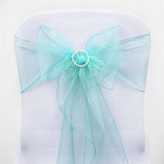 Turquoise Organza Chair Sash | eFavorMart /  Beautiful and charming crystal organza chair sashes are a real treat to eyes and big attention grabbers. Add that sophisticated touch of chic elegance into your event's décor with our splendid sheer organza chair sashes. Made from premium quality nylon, these chair sashes will impart an impeccable sheen and glossy luster to your plain reception or wedding chairs and chair covers, creating that super WOW factor you so eagerly want to attain. Wrap…