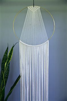 Dreamy handmade macrame wall hanging, made from 3mm natural white cotton rope and a 14 brass ring. Features a sleek modern design and long fringe. Choose between 60 and 75 total length. Shown here in 75 length. Would make a lovely gift!  *NEW* hand dyed black rope is now available! (Please note: as this is hand dyed, this is not a pure dark black!)  This item is MADE TO ORDER! Please allow 3-5 business days for production.  ✦ 6 Ring Version ✦ www.etsy.com/listing/263389468  ✦ 10 Ri...