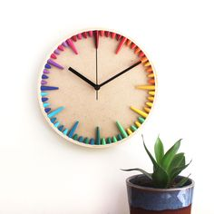 This eco-friendly rainbow clock is a perfect combination of modern and quirky. Use in a neutral interior for a touch of color, or match to one of your accents. The clock dial has a colorful gradation of rainbow paper beads as hour and minute indicators. The beads are handcrafted from exquisite eco-friendly paper. Makes the perfect first anniversary gift for your wife. Rainbow Magic, Rainbow Paper, Rainbow Wall, Paper Bead Jewelry, Paper Beads, Rainbow Decorations, Eco Friendly Paper, Bohemian Art, House Colors