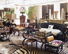 In the living room, a velvet-covered Jansen chair, a Geraldo de Barros chair upholstered in a wool fabric, and a leather side table by Jacques Adnet; the rug was designed by Rollo.